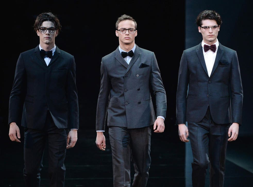 Models present creations by Emporio Armani at the Fall/Winter 2014 Men's collection