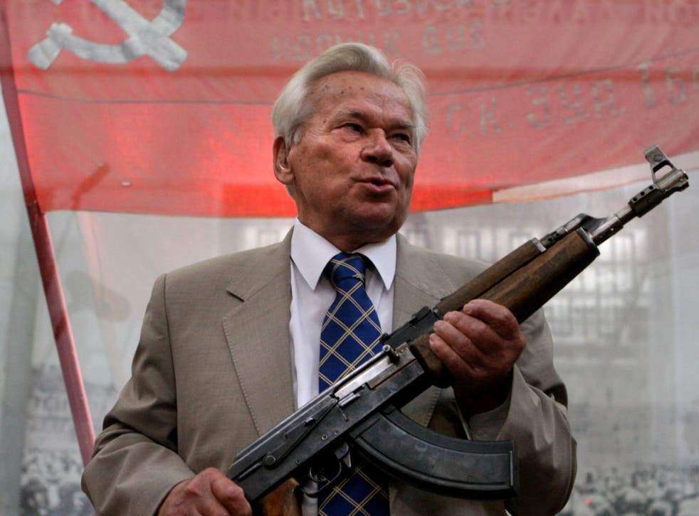 Mikhail Kalashnikov posing with the first model of his legendary AK-47 - he died on 23 December, 2013 at the age of 94