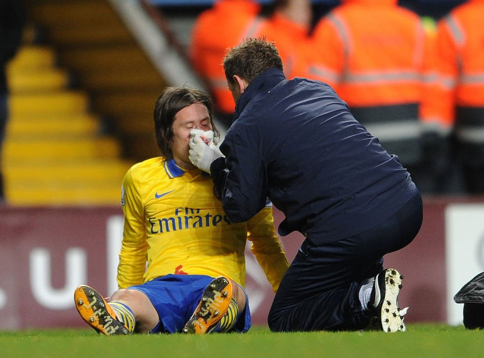 Tomas Rosicky receives treatment after catching a stray elbow off Aston Villa striker Gabriel Agbonlahor during Arsenal's 2-1 victory