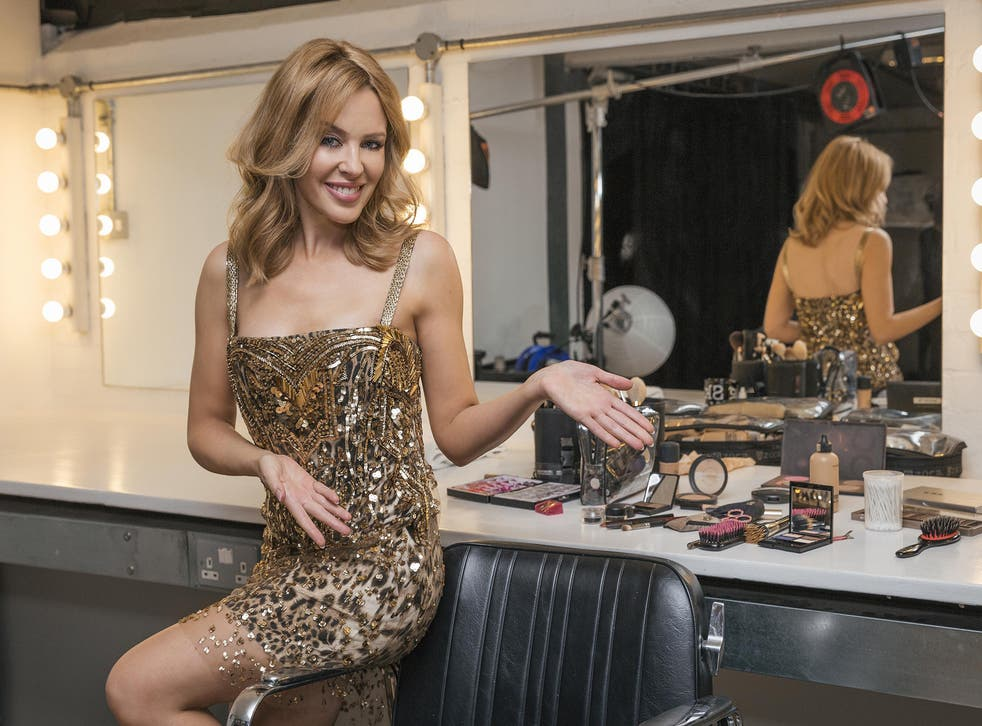 Kylie Minogue in her dressing room to announce a run of comeback gigs