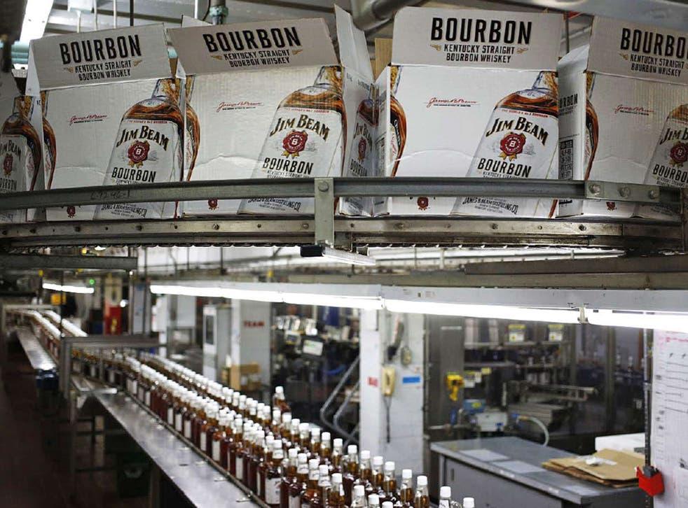 Bottles of Jim Beam Bourbon make their way down a conveyor belt inside the bottling plant at the Jim Beam Bourbon Distillery