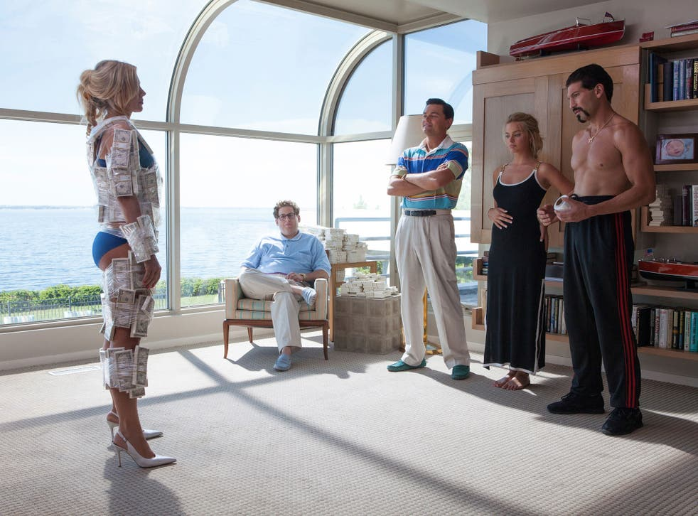 Cash strapped: Leonardo DiCaprio (centre) stars in Martin Scorsese's raucously enjoyable 'The Wolf of Wall Street'