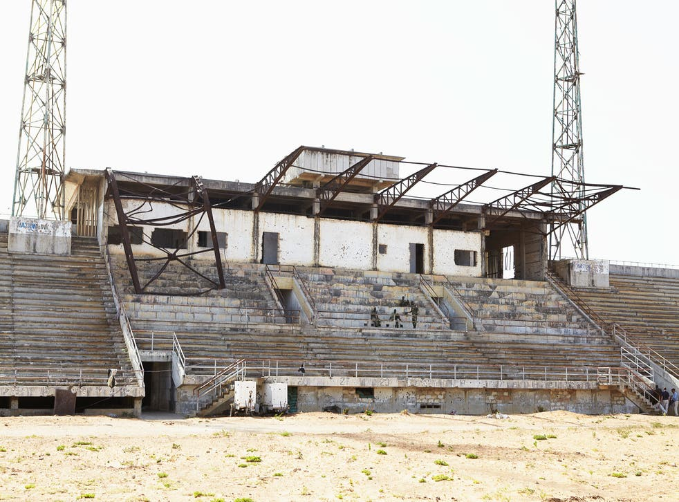 Mogadishu stadium was reduced to a shell when it became a centre for the fighting in the Somali capital. Al- Shabaab used it as a base until their men were forced out by Africa Union troops, now seen relaxing on its main stand
