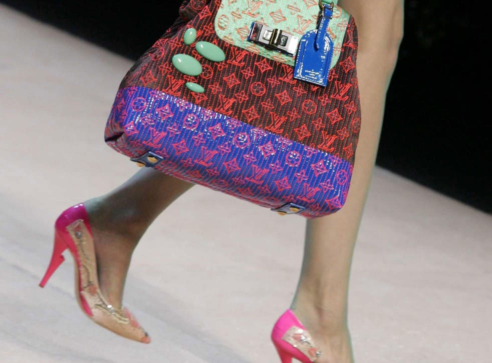 Louis Vuitton is finding that customers no longer buy handbags for the logo and is changing tack