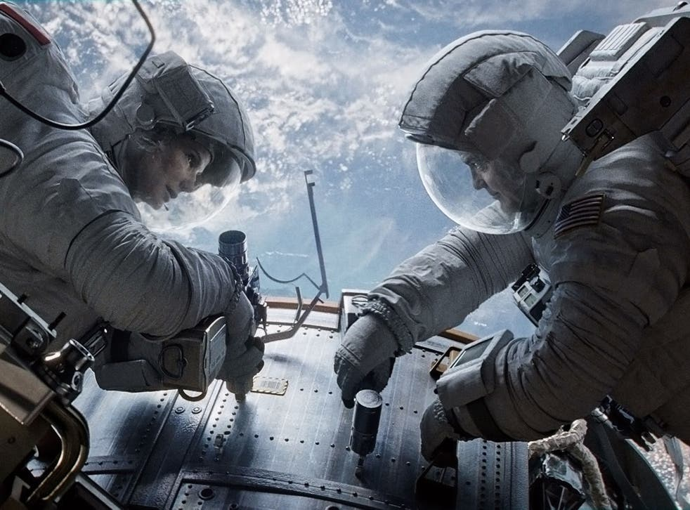 Sandra Bullock and George Clooney in Alfonso Cuaron's Gravity