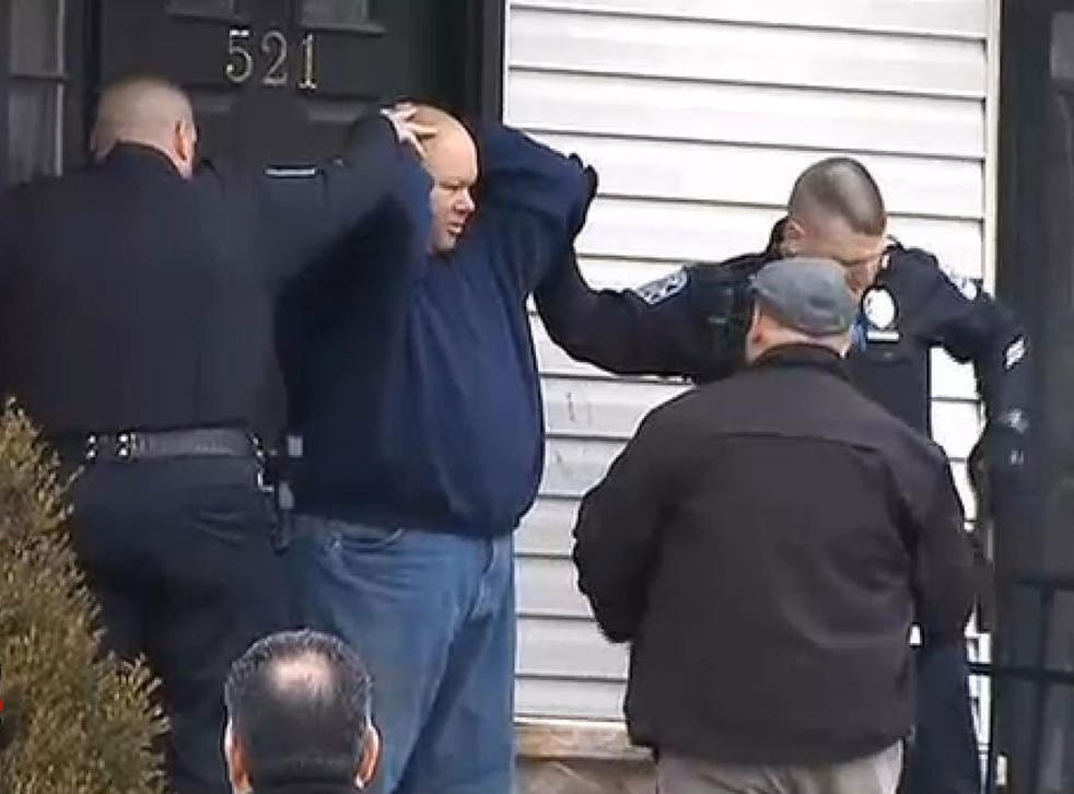 Chris Pagano as he is arrested by armed police