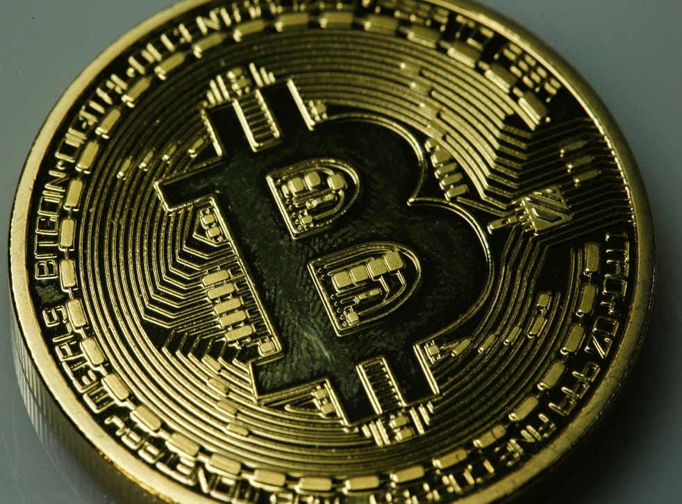 Bitcoin is a peer-to-peer currency that avoids central banking systems by letting owners set up their own transactions. The currency's value has fluctuated dramatically since its introduction.