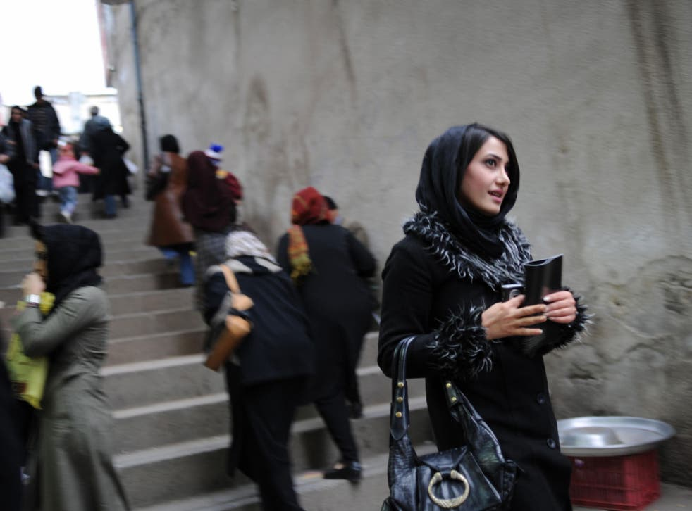 In today's relaxed Tehran, headscarves are being worn back from the face