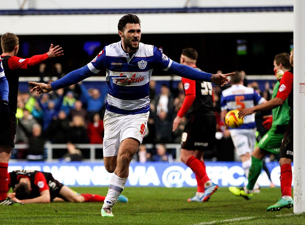 Charlie Austin scored twice to give QPR a 2-1 win over Huddersfield