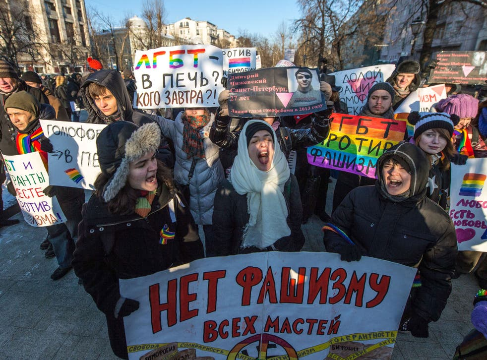 Protesters at an anti-fascist rally in Moscow yesterday. While Mr Putin says protests are allowed, LGBT activists report being detained and beaten at gay pride events