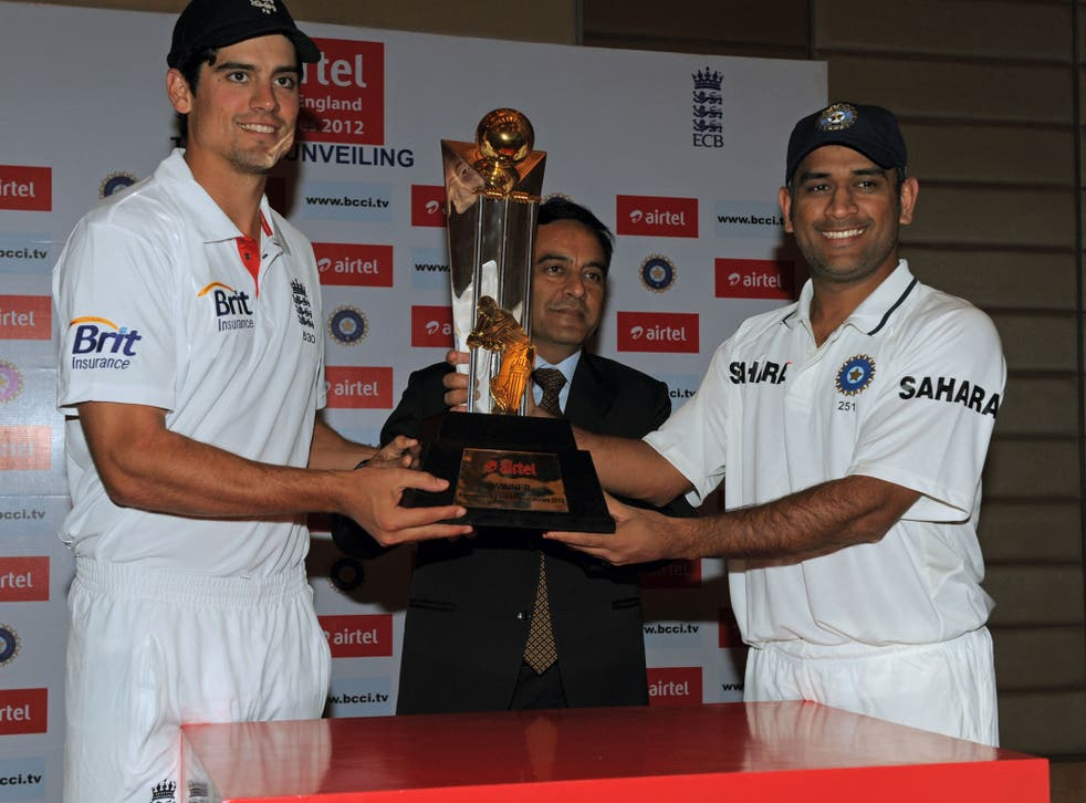 England cricket team captain Alastair Cook (left) and his Indian team counterpart Mahendra Singh Dhoni (right) pose with the championship trophy with Bharti Airtel Gujarat CEO Anant Arora (centre) in Ahmedabad in November 2012