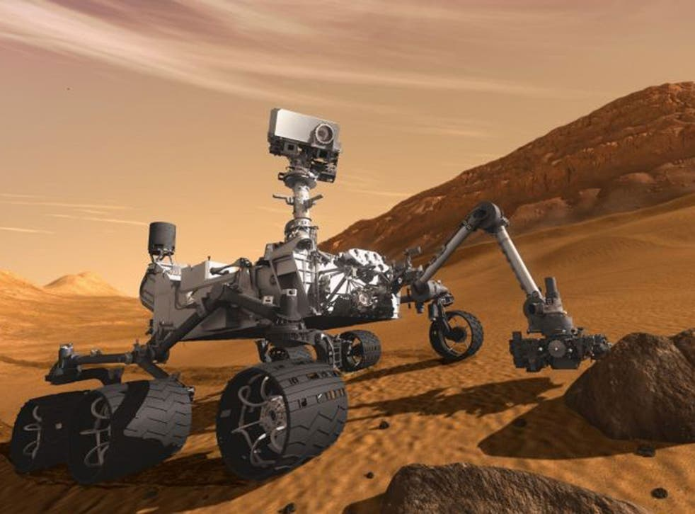 Mars Science Laboratory Curiosity rover examines a rock on Mars with a set of tools at the end of its arm, which extends about 2 meters (7 feet)
