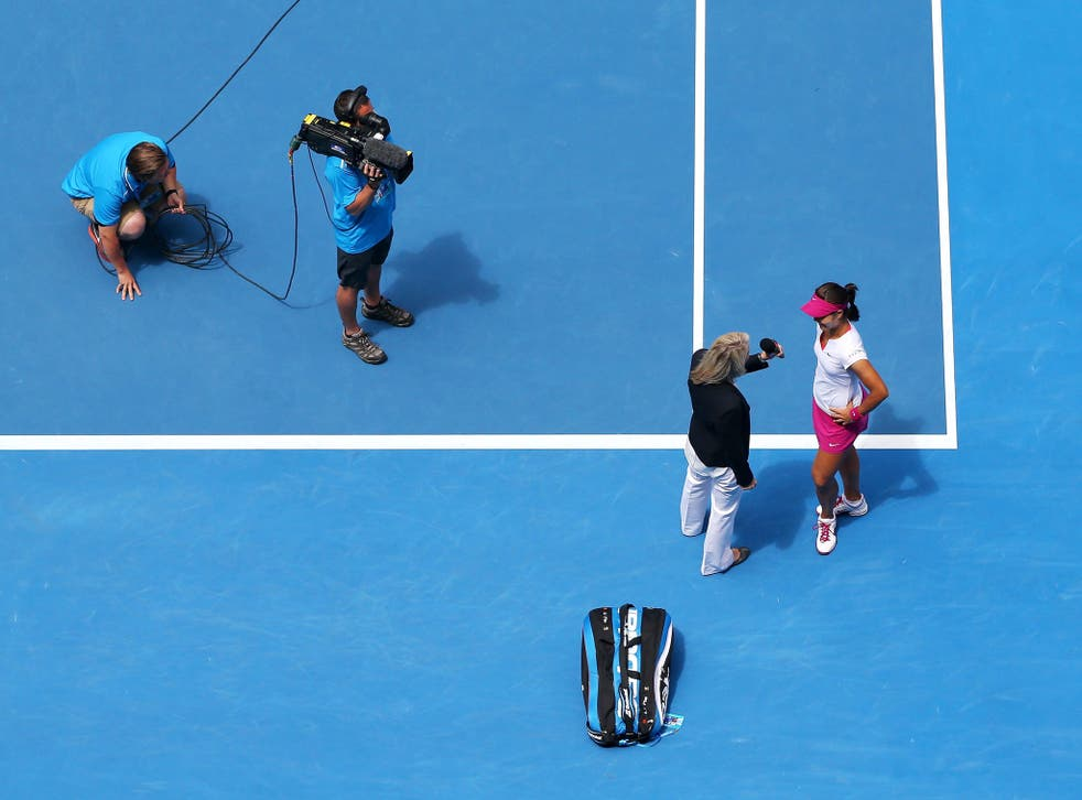 Na Li of China is interview on court after winning her quarterfinal match against Flavia Pennetta