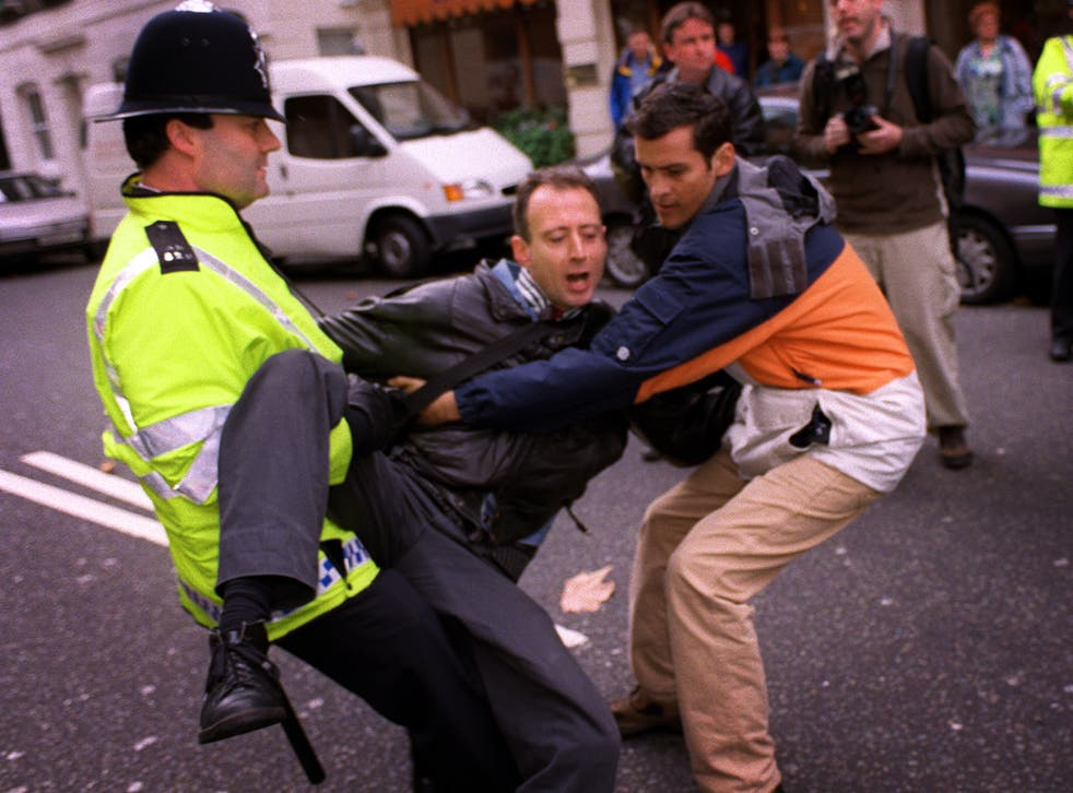 A rights tussle: Peter Tatchell attempts to arrest Robert Mugabe in 1999, in London