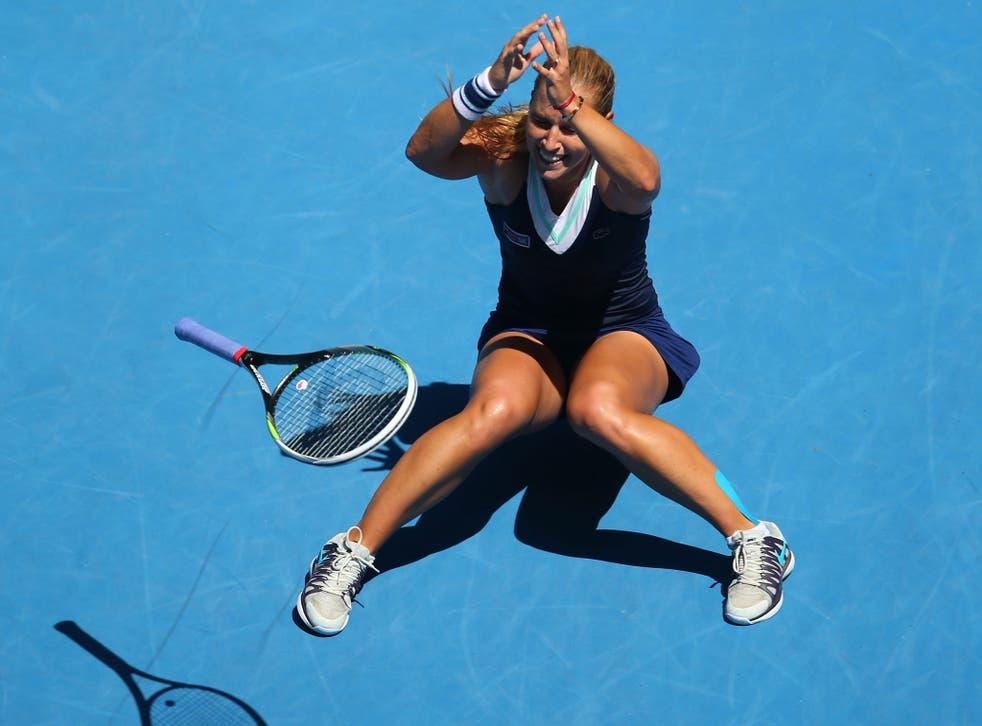Slovakia's Dominika Cibulkova celebrates after victory in her women's singles quarter-final against Romania's Simona Halep