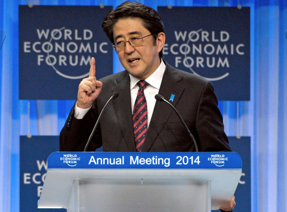 Japanese Prime Minister Shinzo Abe delivers his special address at the opening session of the World Economic Forum in Davos
