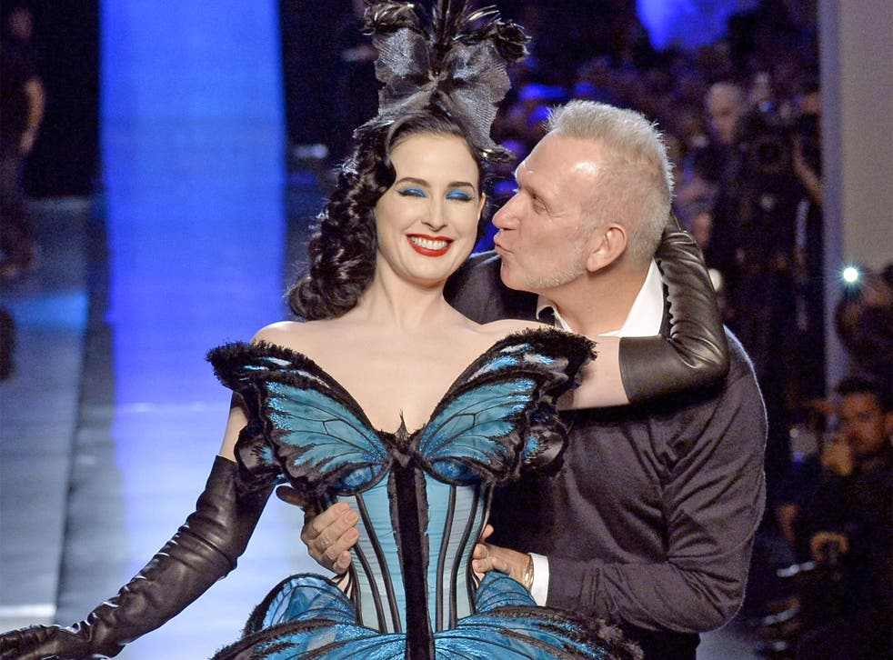 Model and burlesque dancer Dita Von Teese gets a kiss from Jean-Paul Gaultier