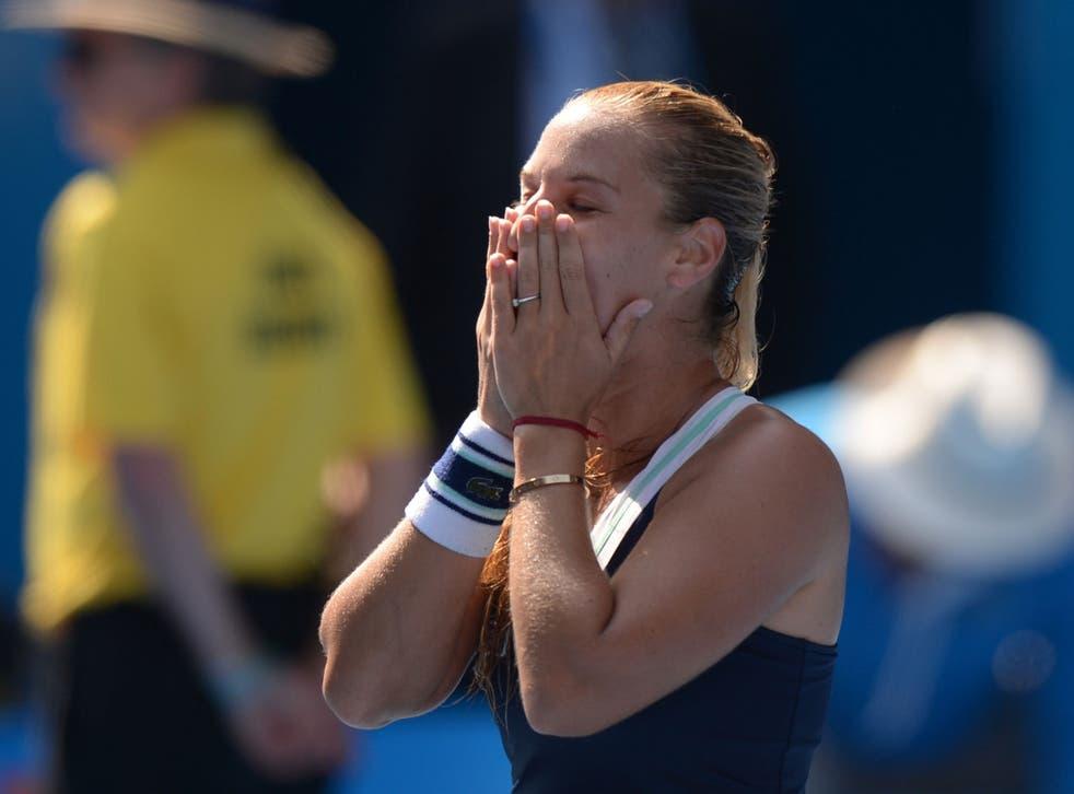 Dominika Cibulkova celebrates after beating Agnieszka Radwanska to progress to the Australian Open final