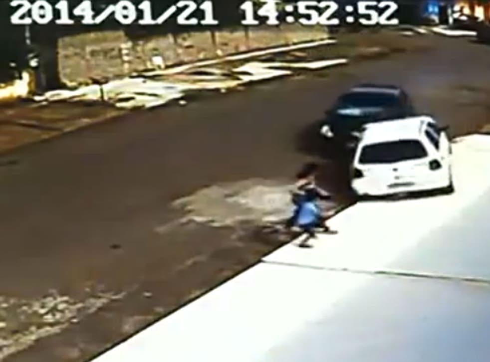 Footage posted online showed the extraordinary moment this woman and child were mown down by an out-of-control car - and jumped straight back up