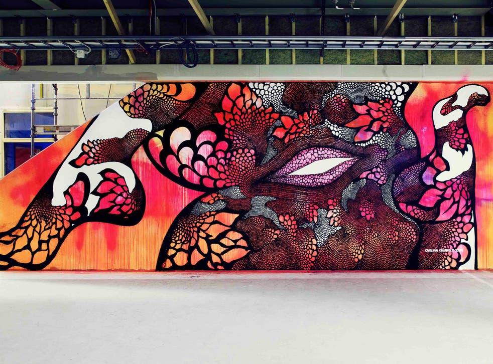 Carolina Falkholt's smiling vagina mural, 'Övermålning', is at risk of removal after politicians deemed its school setting 'inappropriate'