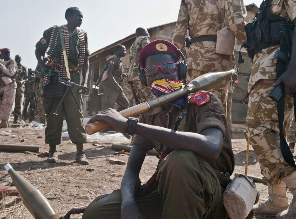 South Sudanese government soldiers wait to board trucks and pickups; a cessation of hostilities agreement in Addis Ababa that should at the least put a pause to five weeks of warfare has been reached
