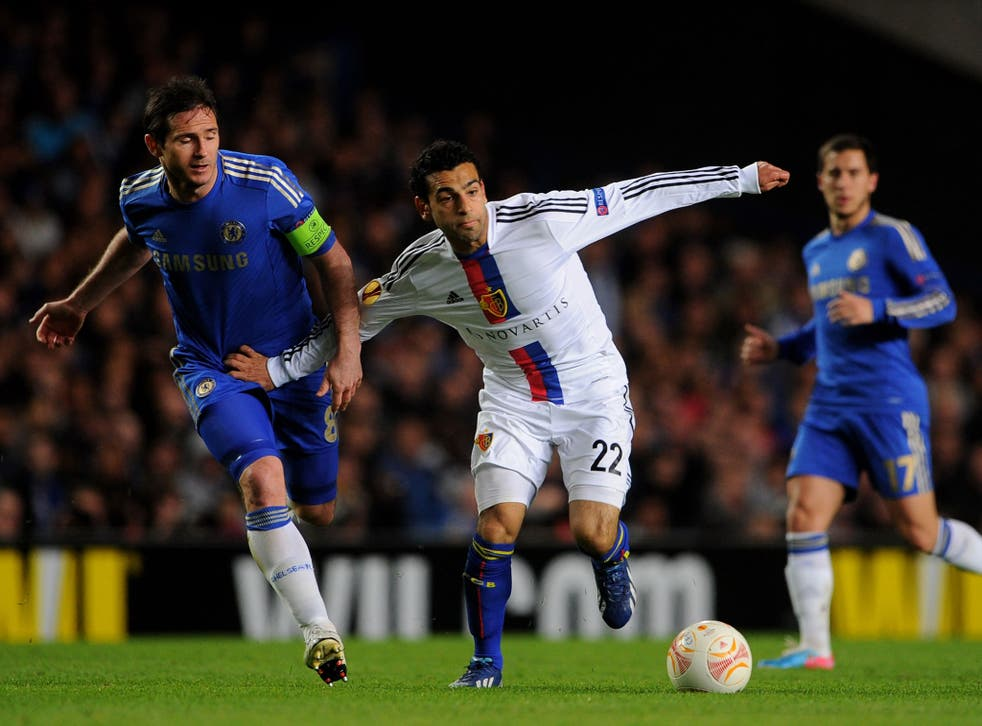 Mohamed Salah, of Basel, holds off Chelsea's Frank Lampard during their Europa League semi final second leg at Stamford Bridge last May