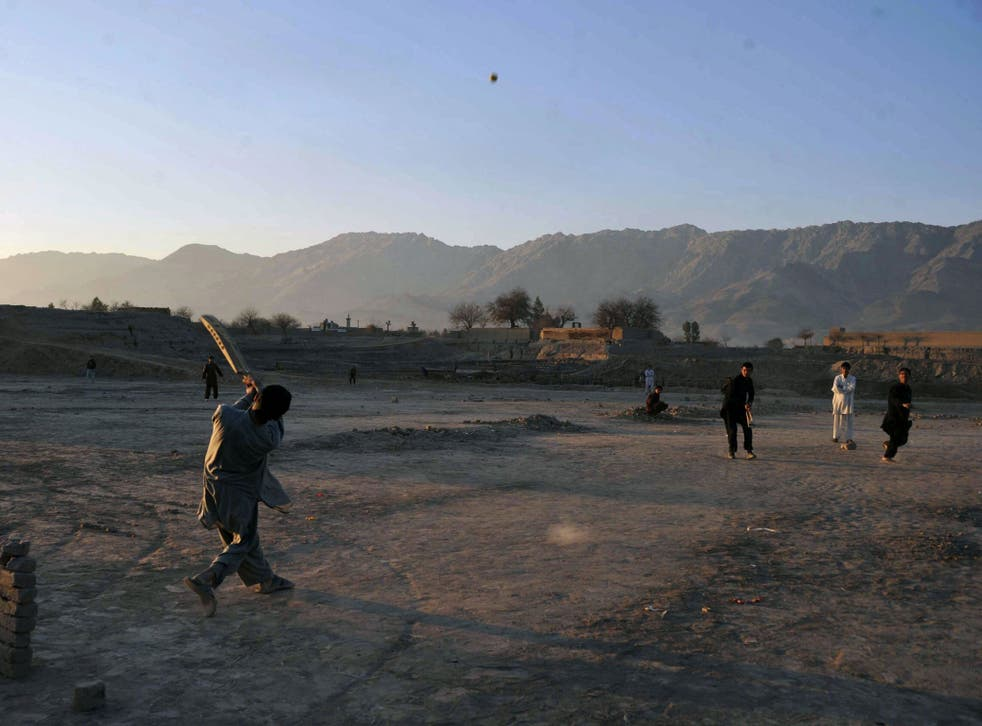 Afghan children play cricket on the outskirts of Jalalabad, Nangarhar province, near to Alinghar, Laghman where the cricket players were shot by a gunman.