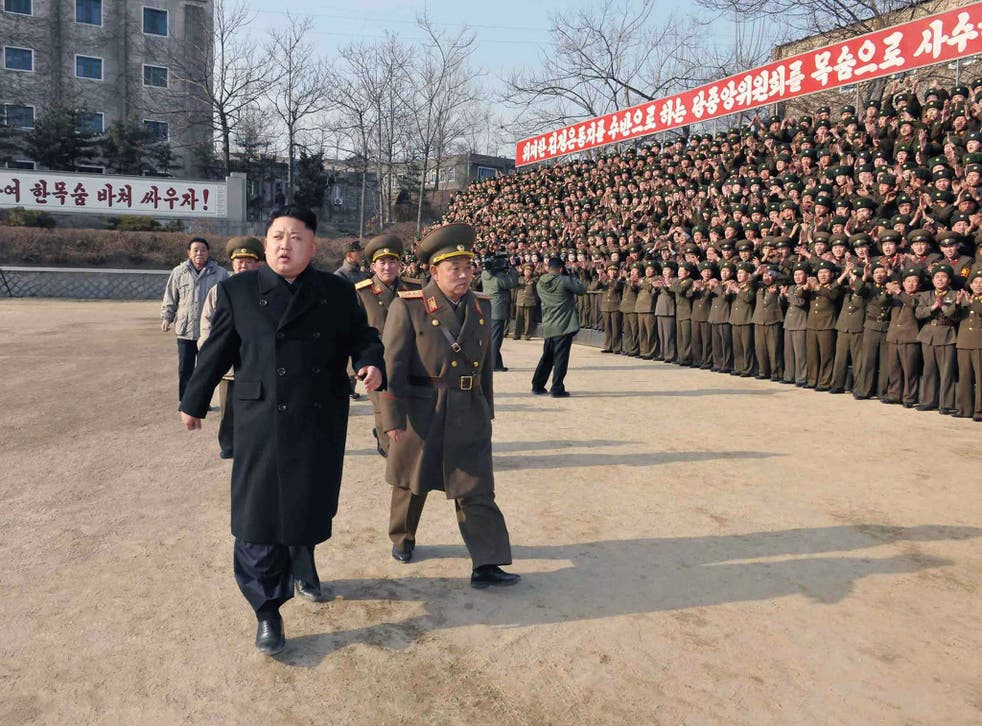 """North Korean leader Kim Jong-Un (left) inspects the command of Korean People's Army. The country's Defence Commission has sent an open letter to South Korea calling for an end to """"hostile military tactics"""""""