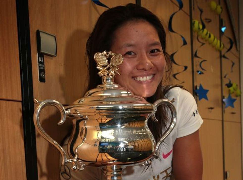 All smiles: China's Li Na celebrates with her second Grand Slam trophy