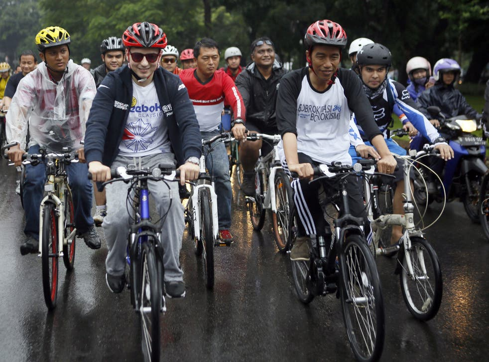 Jakarta's governor, Joko Widodo, (front right) this month