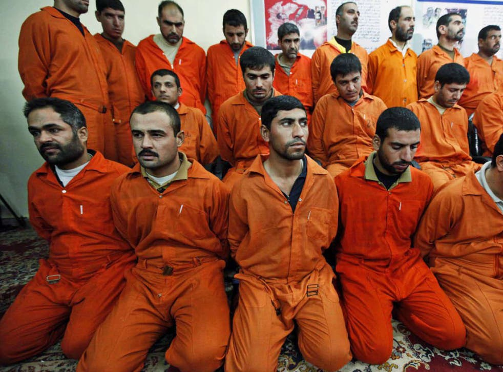 Suspects accused of having links to al-Qa'ida are shown to the press at a Baghdad facility. Post-Saddam, Iraq has executed hundreds of prisoners, many of them following 'confessions' before their trials