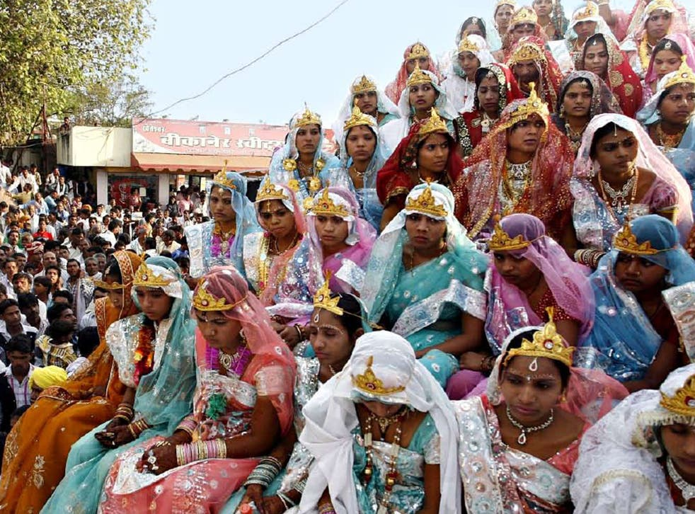 Brides in Bhopal, taking part in a mass marriage ceremony last May, on what is deemed to be the year's most auspicious day to wed
