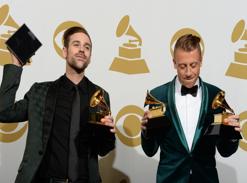 Macklemore and Ryan Lewis with their four Grammy awards