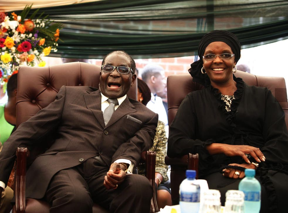 Robert Mugabe ad his wife Grace Mugabe at his sister's funeral. The British government has come under fire for hosting a delegation of Zimbabwean businessmen, some of whom were related to Mugabe's regime