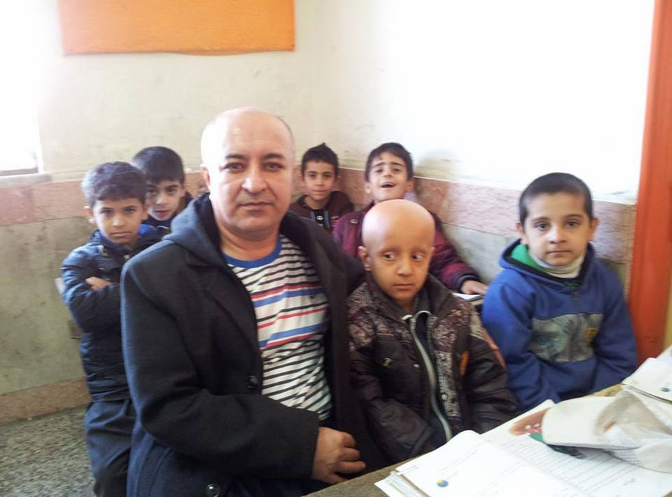 Iranian Teacher Ali Mohammadian with 8-year-old Mahan Rahimi, in a photo taken before Mahan's classmates followed their teacher and also shaved their hair.