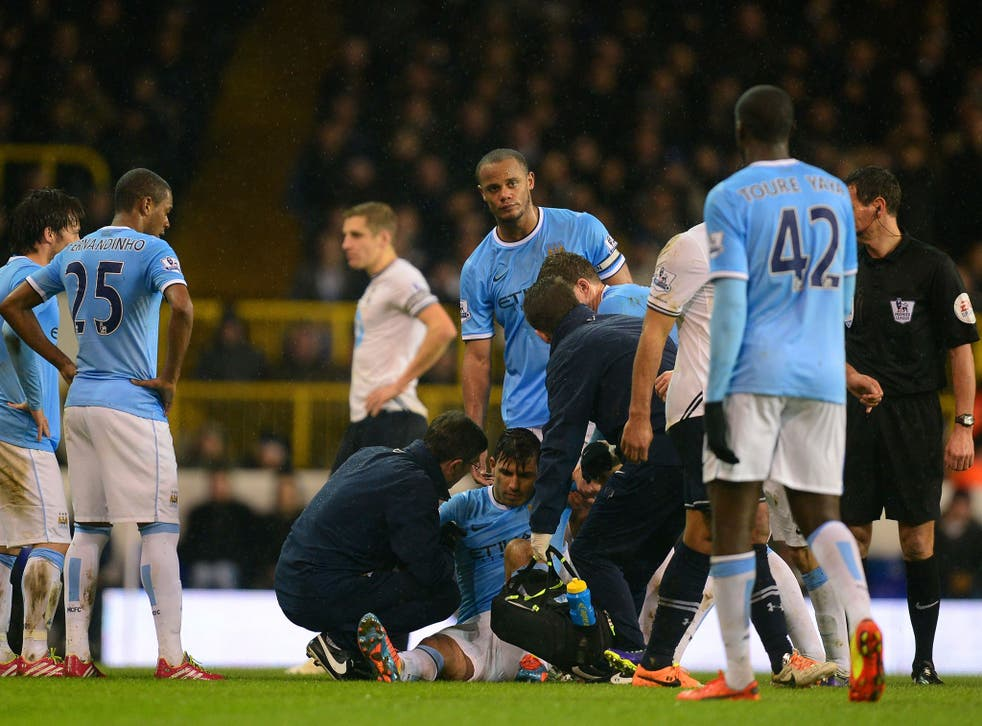 Sergio Aguero receives treatment on a hamstring injury during Manchester City's 5-1 win over Tottenham