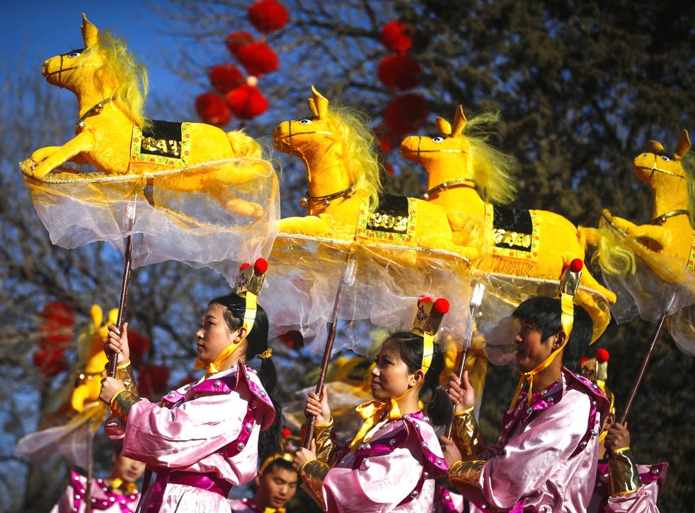 Performers do the horse dance on the evening of the Lunar New Year, or Spring Festival, at a park fair in Beijing
