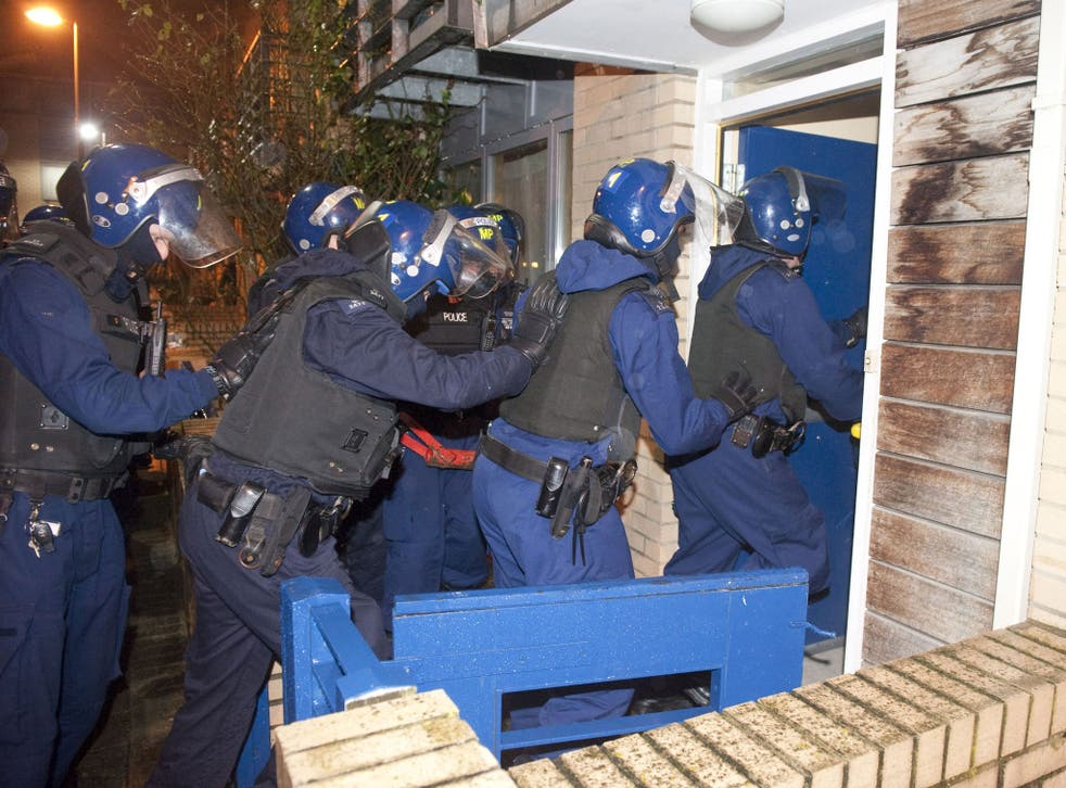 Metropolitan Police of officers entering a property in Marcella Road, SW9, as police targeted a notorious gang in a series of early morning raids across the UK