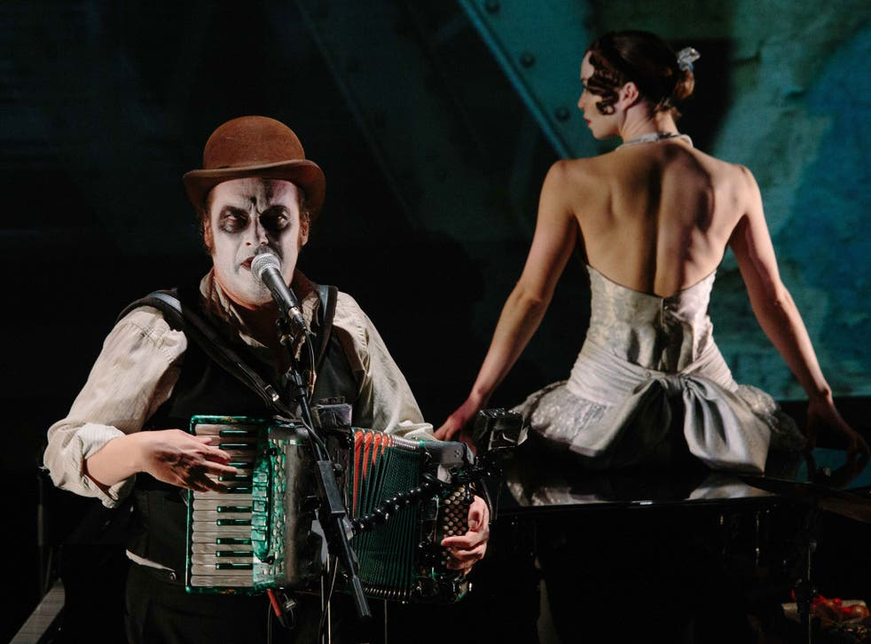 Direction and design by Mark Holthusen, words and music by Martyn Jacques, performed by the Tiger Lillies and Laura Caldow, commissioned by Opera North Projects.