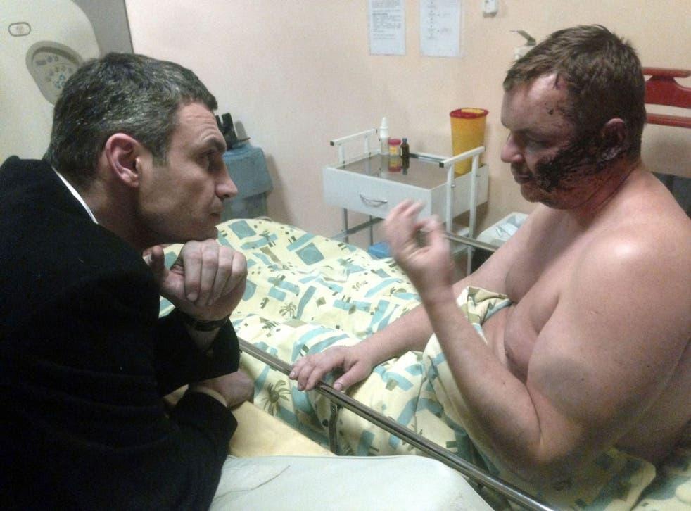 Opposition leader Vitali Klitschko visits Dmytro Bulatov, who claims he was tortured, in hospital, in Kiev