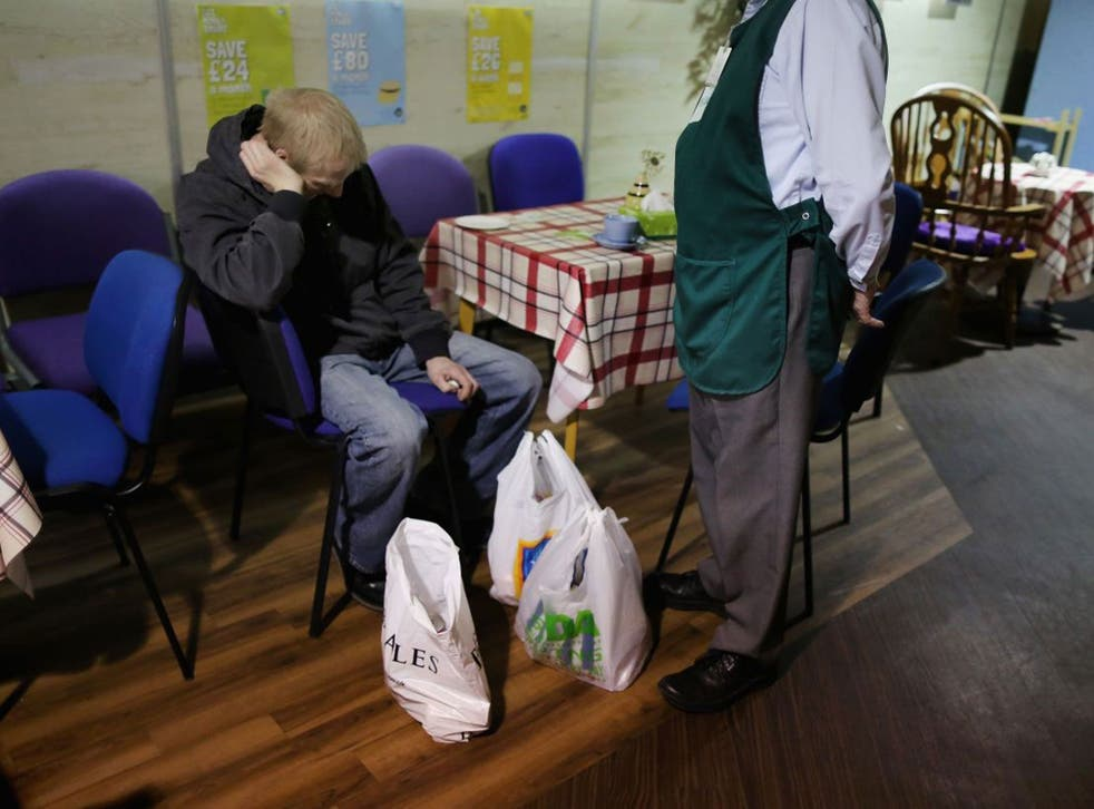 An overwhelmed man collects food from his local food bank