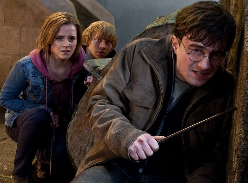 Emma Watson plays Hermione in the Harry Potter films, flanked by Ron (Rupert Grint) and Harry (Daniel Radcliffe)
