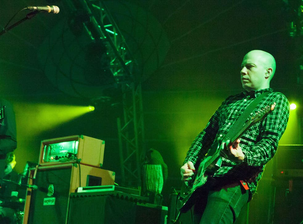 Green zone: Dominic Aitchison of Mogwai, performing in Glasgow