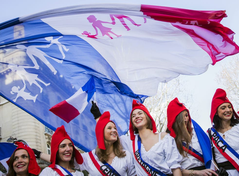 Protesters don revolutionary garb at the 'Protest for All' in Paris yesterday. About 200,000 people attended the largely trouble-free rally, nominally against gay marriage