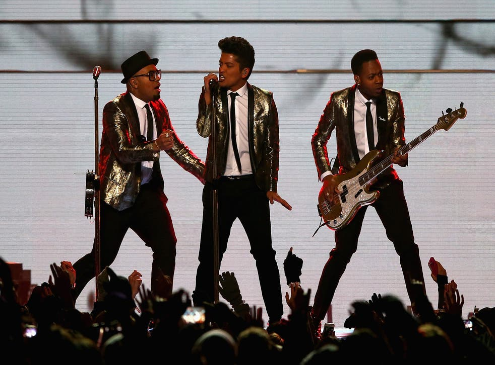 Bruno Mars performs with his backing men during the Super Bowl Halftime show