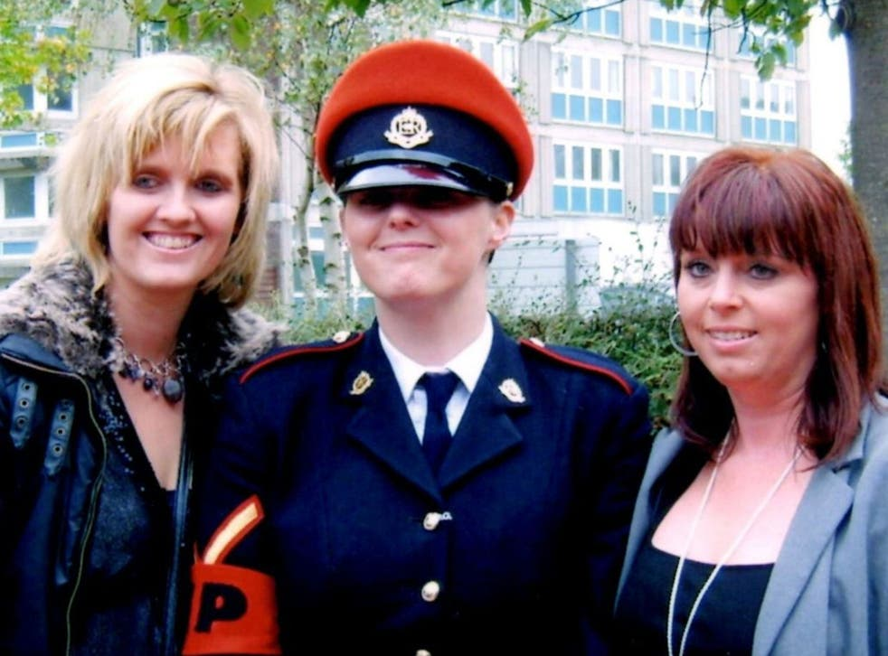 A family handout photograph of Corporal Anne-Marie Ellement, 30, who was found hanged at Bulford Barracks in 2011 after saying she had been raped. She is pictured with with her sisters, Khristina Swain (left) and Sharon Hardy