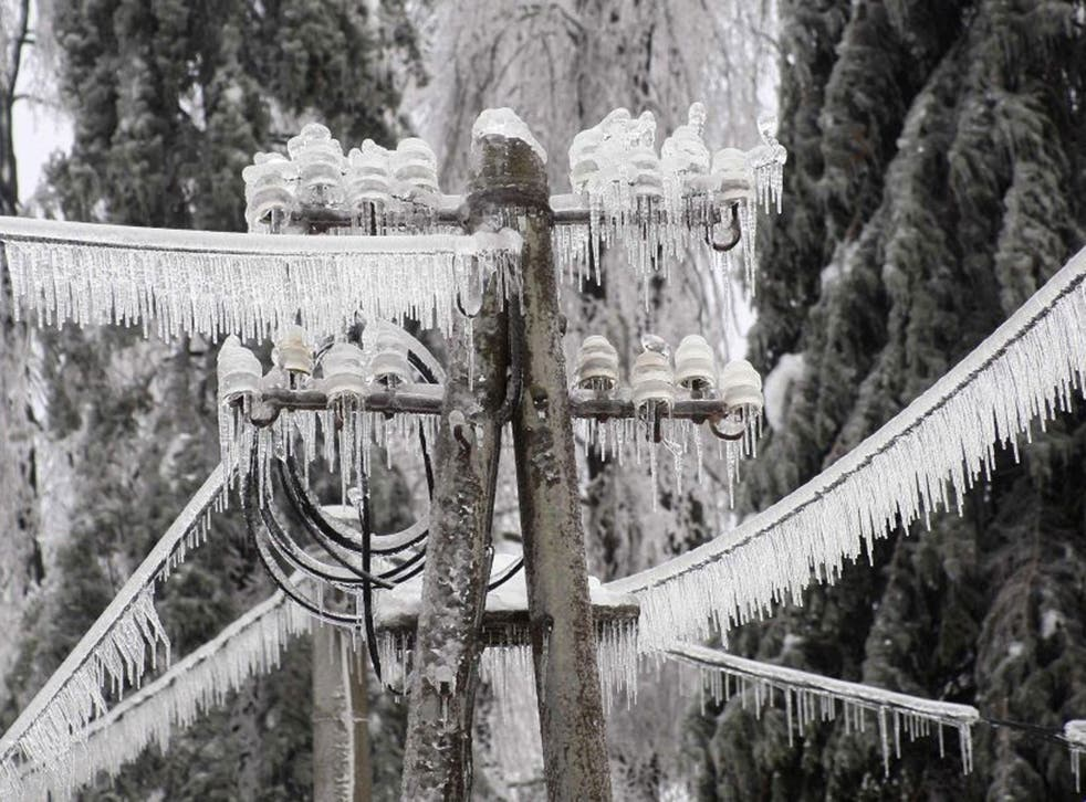 Ice-covered electric power pillar is seen in Postojna