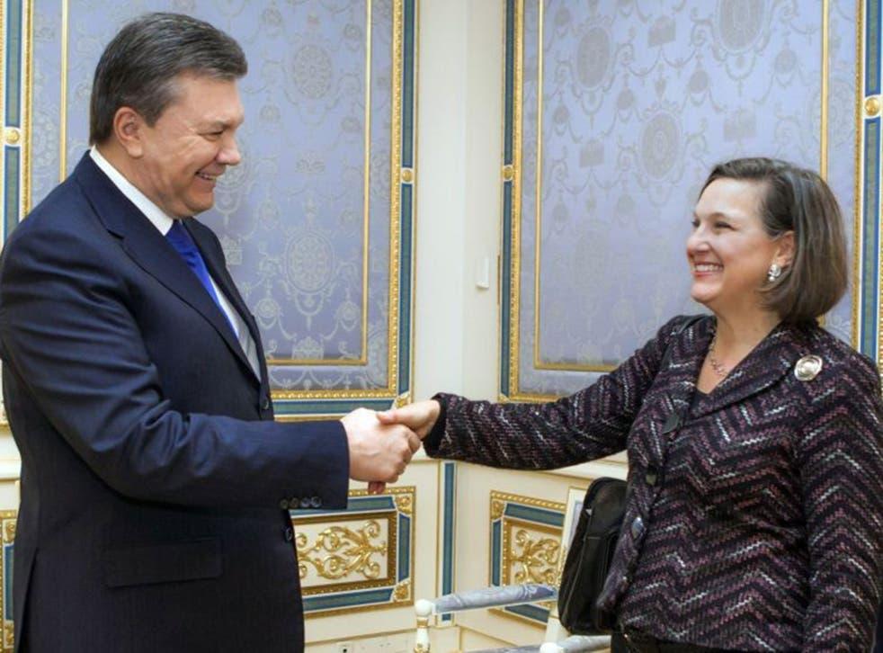 Victoria Nuland greets the Ukrainian president Viktor Yanukovych