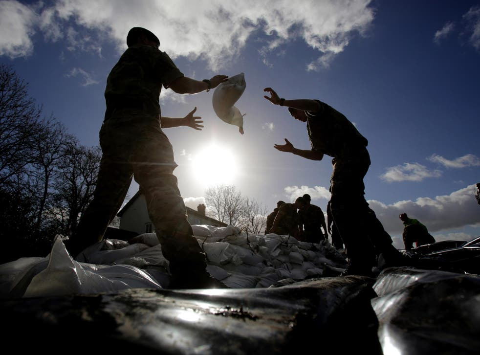 Marines from 40 Commando help build a sandbag wall around a property in Moorland as they help with flood defences on the Somerset Levels near Bridgwater