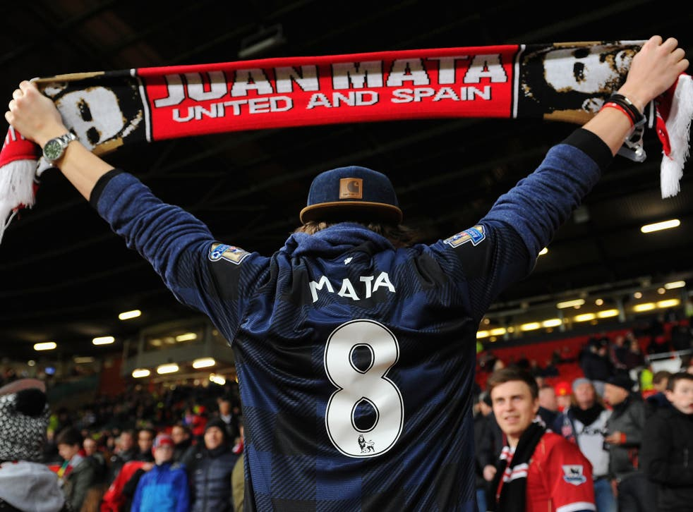 A Manchester United fan shows his support for Juan Mata
